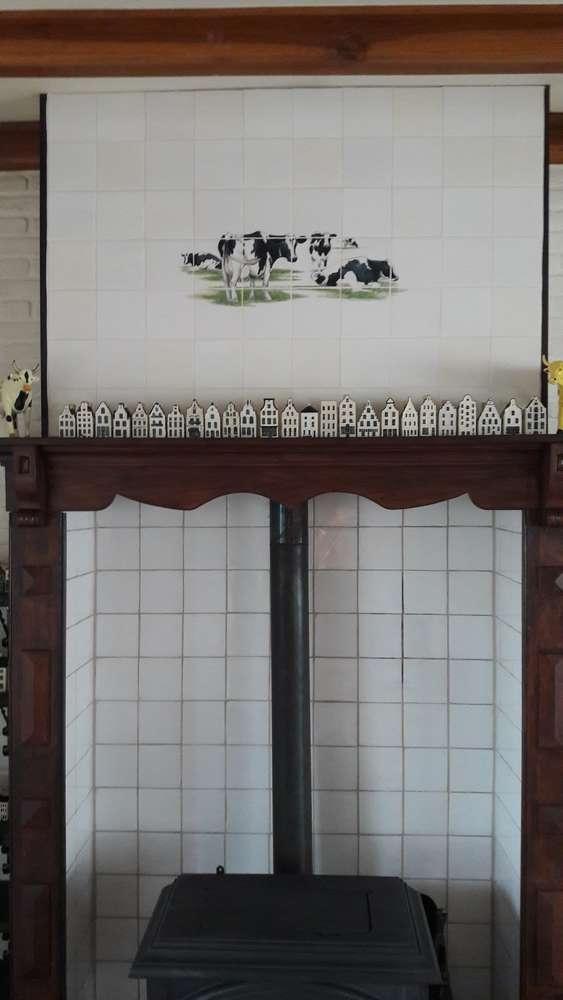 4 zwartbonte koeien in de keuken